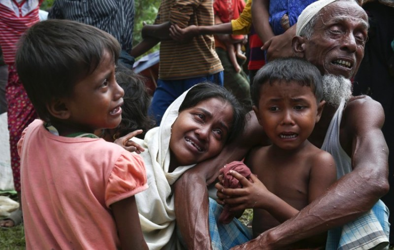 A group of Muslim Rohingyas in Ghumdhum, Cox's Bazar weep as Bangladesh border guards (not pictured) order them to leave their makeshift camp and force them out of the country, Monday, Aug. 28, 2017. Since 2012, more than 1,000 Rohingya have been killed, some 320,000 live in squalid camps in Myanmar and neighboring Bangladesh, and thousands have embarked on perilous sea voyages to other Southeast Asian countries, according to estimates by the U.S.-based Human Rights Watch and the United Nations. (AP Photo/Mushfiqul Alam)