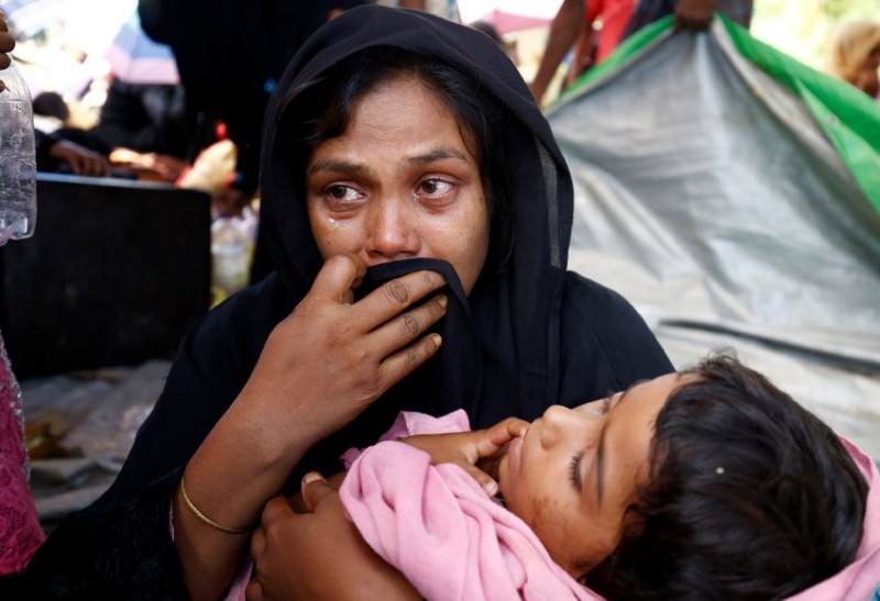 A Rohingya woman cries as the Member of Border Guard Bangladesh (BGB) restrict them from entering Bangladesh, in Cox's Bazar, Bangladesh, August 27, 2017. REUTERS/Mohammad Ponir Hossain
