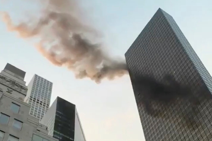 A smoke is seen rising from the roof of Trump Tower, in New York, U.S., January 8, 2018 in this still image obtained from social media video. TWITTER/@NYCBMD/via REUTERS THIS IMAGE HAS BEEN SUPPLIED BY A THIRD PARTY. MANDATORY CREDIT. NO RESALES. NO ARCHIVES. MUST ON SCREEN COURTESY TWITTER/@NYCBMD - RC196254DC00